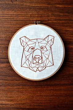 Geometric bear embroidery from Pumora