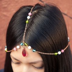 I've always liked beaded headpieces like this. I think I may make one for spring/summer!