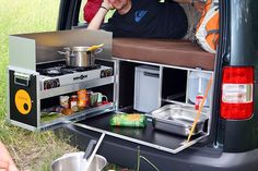 The QuQuQ camper in a box is also from Germany and includes a bed platform with foam mattress, a two-burner stove, 20 liter water tank, sink, storage and work space. The entire system can be set up in a van in just a few minutes by two people. The QuQuQ system can be used in a van without having to remove the back seats.