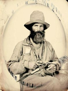chubachus:Ambrotype portrait of an unidentified Confederate soldier holding a revolver.Source.  Fuckin yeah