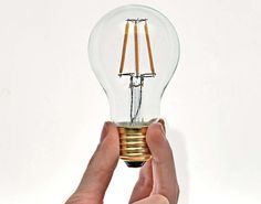 Aamsco's clear-glass Hybrid LED bulb features a filament design