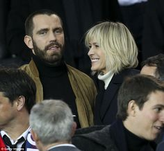Look of love: Clement may have been watching the game, but the actress only had eyes for h...