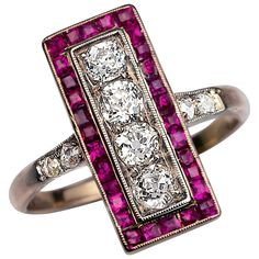 Antique Russian Diamond Ruby Ring. made in Moscow between 1908 and 1917  a silver topped 14K gold ring vertically set with four old European cut diamonds framed by calibre cut natural and synthetic rubies  estimated total diamond weight 0.65 ct