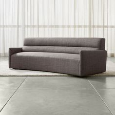 Shop Sydney Curved Sofa.   Hugging the sofa's streamlined design, the durable fabric adds energy with a dynamic strié weave that layers on tones of grey and refreshing visual interest.  The Sydney Sofa is a Crate and Barrel exclusive.