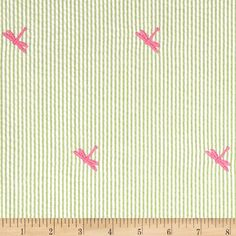 Embroidered Seersucker Lime/White Dragon Fly Pink from @fabricdotcom  This lightweight, woven seersucker fabric is light and summery. This versatile fabric is perfect for stylish summer suits, dresses, shorts and children's apparel. It can also be used for very lightweight curtains, home decor accents and even bedding accessories. Features green and white stripes with hot pink embroidered dragonflies throughout.