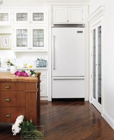 Hardwoods on an angle: White and wood kitchen via Style At Home.  Photography by Donna Griffith.