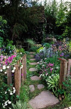 Rustic garden... so simple and inviting. A simple stone pathway creates a natural look framed by beautiful gardening.