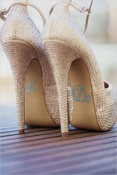 """Swarovskicrystal wedding shoes with an, """" I Do,"""" label on the back."""