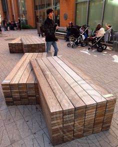 Wooden Bench at Public Plaza, 8 Spruce Street - Beekman Tower in the Financial District of downtown Manhattan, New York City, NY - photo by jag9889, via Flickr   ...It looks like stacks of 2x4s...