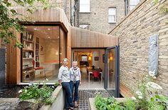 Barbara Webster with her daughter, Lizzie, co-founder of Fraher Architects who designed the basement's transformation.Gloomy, badly lit rooms, a slight subterranean dampness and the sight of strangers' feet glimpsed on the pavement outside the barred windows: everyone knows the unappealing cliché of the urban basemen