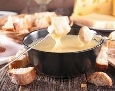 Fondue can be just as much fun to make as it is to eat! This is a basic cheese fondue recipe that is extremely versatile. Make this cheese fondue in a matter of minutes over the stovetop or directly in your fondue pot. Swiss Cheese Fondue, Gruyere Cheese, Comte Cheese, Queso Brie, Queso Fundido, French Dishes, Melted Cheese, Popular Recipes, Gastronomia