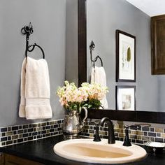 Beautiful bathroom! We love using a silver pitcher filled with flowers in the powder room.