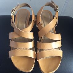 Kenneth Cole Wedges. Tan. 6 1/2. Beautiful tan Reaction wedges. Worn a few times. Great condition. Shoes Wedges