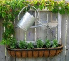 old window, watering can, and windowbox