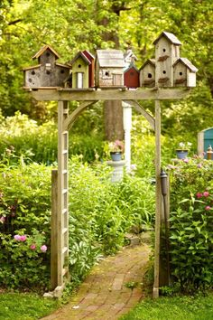 Birdhouses on the garden entry set the mood when you enter your private paradise.  granny54: