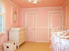 This nursery exudes elegance. The pink walls with white trim and iron crib create a nursery fit for a princess.