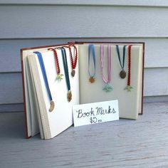 Love the use of a book for a display - Craft Fair Display Ideas: Pack Light and Easy for a Traveling Booth Display Stall Display, Craft Booth Displays, Display Ideas, Booth Ideas, Craft Booths, For Elise, Market Displays, Market Stands, Store Displays