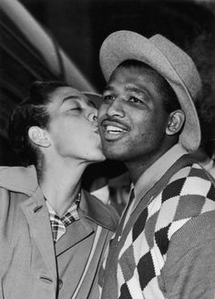 American tennis player Althea Gibson greets American boxer Sugar Ray Robinson on his arrival in London 4th July 1957