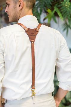 Customized leather suspenders: http://www.stylemepretty.com/2016/05/09/dapper-and-dandy-groom-suspender-style/