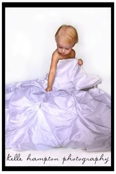 Your daughter wrap in your wedding dress. Then use it for her wedding pictures