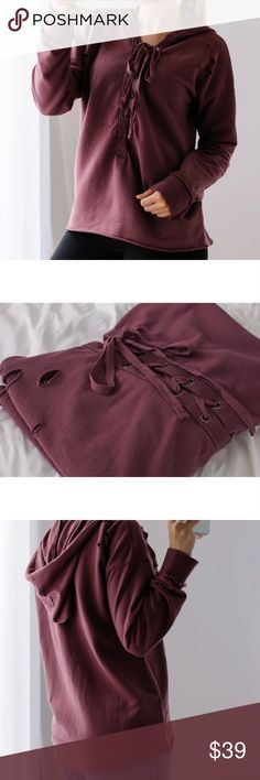 """🆕Plum Lace Up Hoodie ◽️Comfy lace up sweatshirt hoodie in the perfect Fall plum shade! Stylish distressing, raw edges, french terry interior. Cozy and chic! 100% cotton and great quality. You will love this color in person - most accurate in my closeup product photos. S chest across is 19.75"""" and length 23.5"""" -- each size approx 1"""" difference. Looks great with jeans, joggers, over workout clothes. I am modeling S. New.   ▫️Price is firm ▫️10% off bundles of 3+ applies automatically at…"""