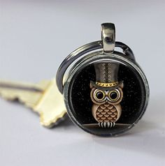 """Steampunk Owl in Black Silver Bezel Glass Tile Keychain. This adorable keychain is made with 1"""" glass and a beautiful silver bezel. Your keychain will arrive in a gift bag, ready for gift giving! * This design is also available as a necklace in my shop!."""