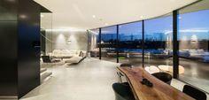 Flexform's Soft Dream sectional is the perfect choice for this ultra modern home in the Netherlands.  #Flexform #Flexformny #newyork #interior #interiordesign #design #industrialdesign #home #decor #homedecor #sidetable #couch #sofa #apartment #luxury #furniture #luxuryfurniture #chic  #monochromatic #blackandwhite