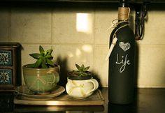 upcycled wine bottle=mini blackboard . Love the coffee mug planters too.