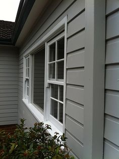 Dulux Milton Moon with Dulux Domino front door and gutters