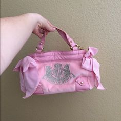 Juicy Couture Purse Pink girls' Juicy Couture purse with two adorable bows on each sides. New with tags. No flaws. Juicy Couture Bags Shoulder Bags