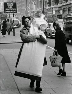 Claes Oldenburg carries a giant tube of toothpaste 1966