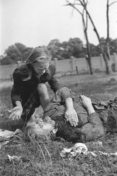 10 year-old Polish girl Kazimiera Mika mourning the death of his sister, caused by strafing German aircraft, near Warsaw, Poland, 13 Sep 1939  Photographer Julien Bryan