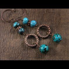 """Speckled turquoise earrings with antique brass Vintage turquoise blue green with black speckles and genuine turquoise stone beads with antique copper rings. These earrings hang 2"""" below antique copper ear wires. Like new--only worn a couple times. Designed by an indie artist. Just listed as Anthropologie for exposure. Please feel free to make offers. Anthropologie Jewelry Earrings"""