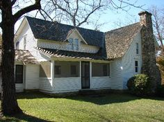 Rear view of the house on Rocky Ridge farm, home of Almanzo and Laura Ingalls Wilder. Oh, the chimney!