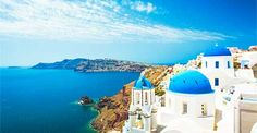 The Greek island of Santorini is known for its blue and white buildings (which happen to be the national colors of Greece). The blue-domed church in the town of Oia is particularly well-known.