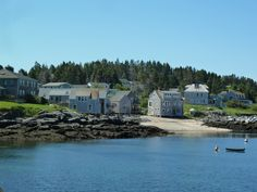 Monhegan Island, Maine.  Find the Fish House restaurant at the cove and eat outside on picnic tables.  Great food.  Coastal Photo by J. Underwood.
