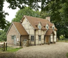 A 'new build' timber framed house by Border Oak http://www.borderoak.com/ England I adore acres of gravel and 5 bar gates! What a dream country home!!!!