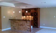 basement bar -love the stone on the front