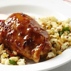 Asian Orange Chicken Thighs with Cauliflower Rice @keyingredient #chicken #delicious