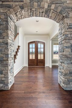 New American House Plan with Separate Game and Play Rooms - 500063VV | Architectural Designs - House Plans Stone Columns, Brick And Stone, Inside A House, My House, Plant Ledge, Stone Interior, American Houses, Cozy Fireplace, Exposed Beams
