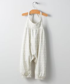 Lovely lines and an adventurous pattern make this tank bodysuit a must-have for the spring! This elegant safari pattern bodysuit features ink-based dyes for washer safe color, so it will stay eye-catching until hand-me-down day. This original print pattern was created by a Hallmark Baby artist and is an online exclusive!