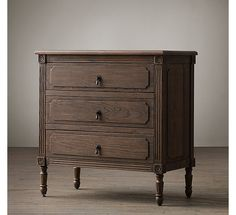 """RH's Louis XVI 30"""" Closed Nightstand:Classic and refined, our nightstand's raised-panel drawers, turned legs, fluted stiles and hand-carved corner blocks with rosette detail reflect its neoclassical French lineage. A soft, weathered finish and antiqued bronze cast-metal pulls lend it relaxed gentility."""