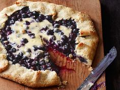 Try this alternative to cheesecake made with flaky pastry dough, sweet cream cheese and bursting blueberries for a Labor Day dessert that can be sliced and served to a crowd. #LaborDay #Blueberry #Seasonal #Cheesecake #Galette