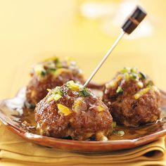 Tapas Meatballs with Orange Glaze Recipe -Crisp on the outside, moist on the inside, these baked cheese-stuffed appetizers are drizzled with a tasty sweet-sour glaze. —Bonnie Stallings, Martinsburg, West Virginia