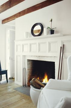 Ralph Lauren Paint's Tibetan Jasmine adds warmth to a fireplace and hearth of a farmhouse living room.