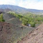 Sicily: hiking in Mount Etna's foot hills, an exotic landscape of black volcanic sand, birch trees, craters and forever views.