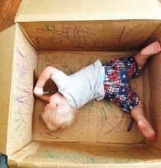 A cardboard box and crayons. Simple hours of entertainment :)