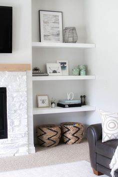 White Floating Shelves In A Niche Are A Great Idea For A Modern Living Room
