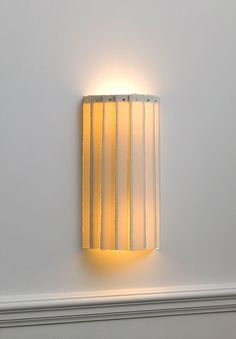 Slender and elegant, the Tall Drum Wall Light compliments any classic or contemporary interior.