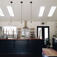 | black kitchen counter | hanging lamps | - feelathomeinterior